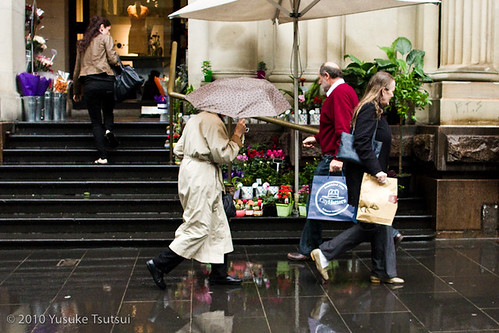 city shoppers in the rain