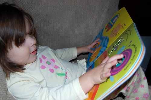 Reading her new Little Scholastic book