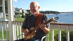 Playing guitar on porch 7AA