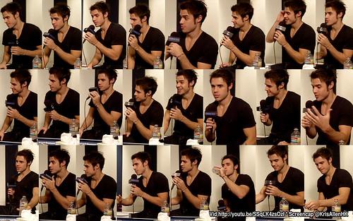 Kris Allen on Billy Bush Show screen cap wallpapers arms biceps chest black shirt tee t-shirt