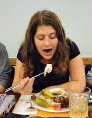 Eating something that looks like octopus sashimi