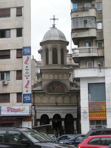Orthodox church squeezed by Communist-era buildings
