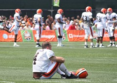 K Phil Dawson looks on