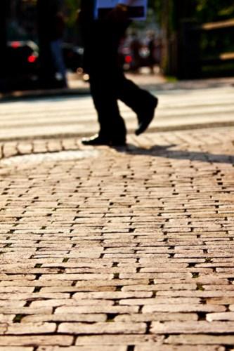 brick sidewalk and legs