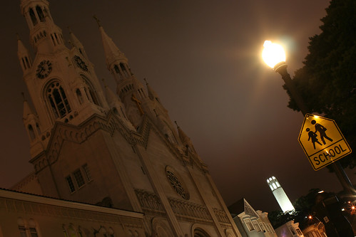 st. peter and paul church, with Coit in the background, at night.