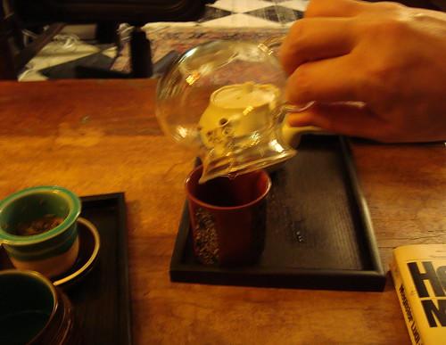 pouring tea: cafe namaste