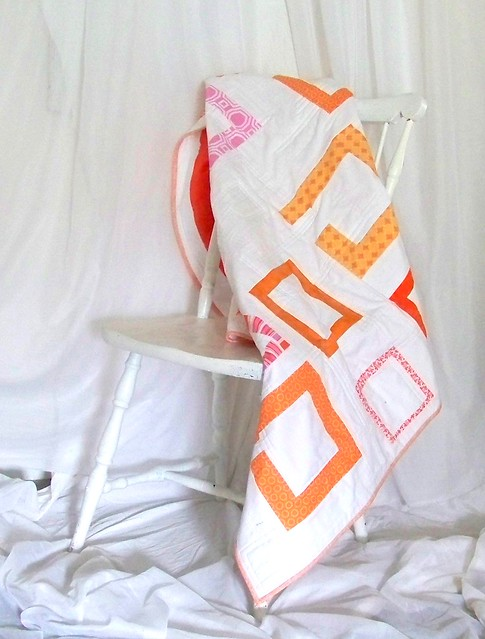 Modern handmade pink orange squares quilt by pioneervalleygirl