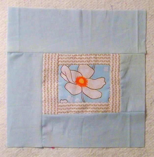 modern square in square quilt block aqua with flower center