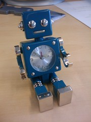 Dark turquoise robot clock
