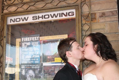 Kissing in front of the theater