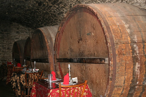 Tables in Catacombs with huge wine barrels