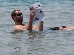 "obligatory ""reading newspaper in the dead..."
