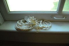 Bracelets and fascinator in the windowsill
