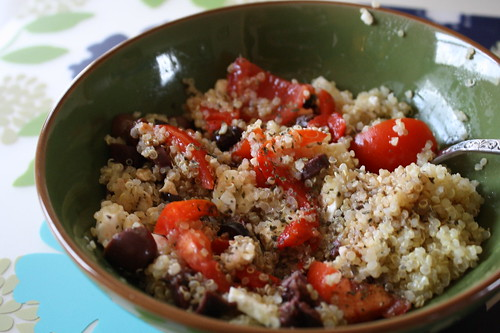 quinoa with tomatoes, kalmata olives, spices, feta cheese, roasted red peppers