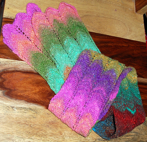 a scarf of many colours, laid out on top of a timber chair