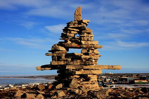 inukshuk in igloolik by arctic-wl