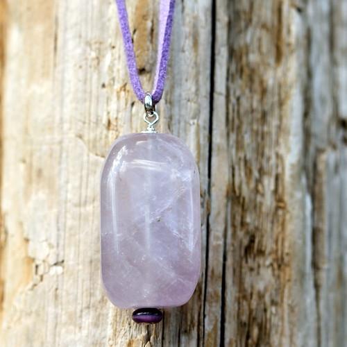 Large gemstone pendant on purple suede necklace