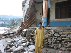 Pakistan floods: Fazal Mowla stands in front o...