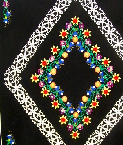 Applique flower and knotwork quilt with black background - vermont quilt festival