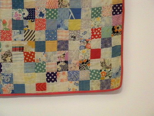Corner detail of small squares patchwork quilt circa 1934