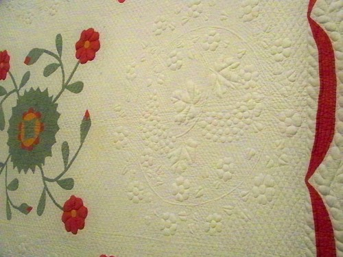 Antique quilt red and green applique wreath and hand quilting