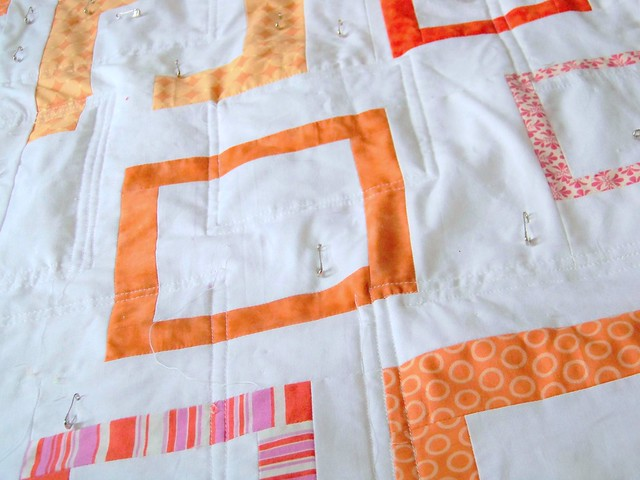 modern patchwork quilt pink and orange squares