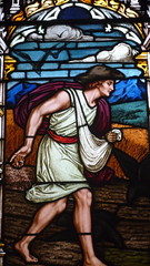 Stain glass window showing a sower