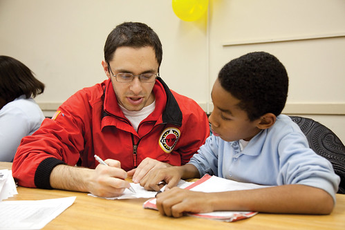 City Year Corps Member and Student
