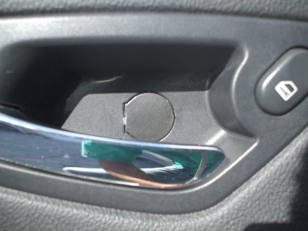 medium resolution of next pry open the cap in the door handle cubby if someone can post a way to not break it that would be great