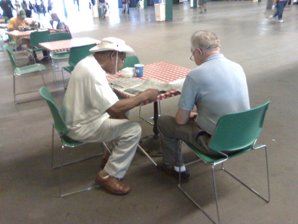 Discussing picks for the next race, Belmont Park, New York