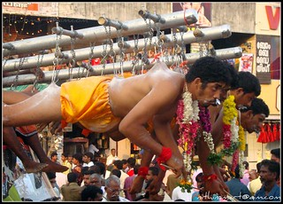 Garudan Thookkam (Eagle Hanging) is a ritual art form performed in Kali temples of south Kerala, south India. The people who dress up as Garuda perform the dance. After the dance performance, the hang-designate dangle from a shaft hooking the skin on his