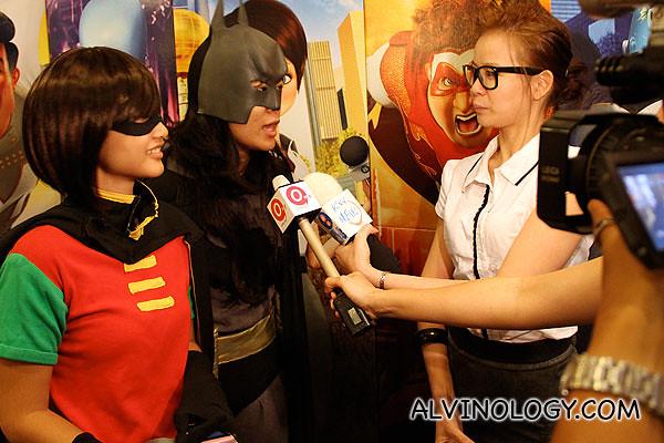 Batman and Robin getting interviewed