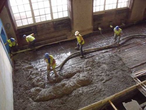 A mucky job ground floor slab being poured
