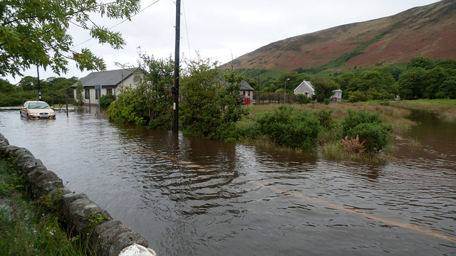 Flooded road in Lochranza, with stranded car