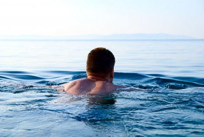 Man swimming in the ocean