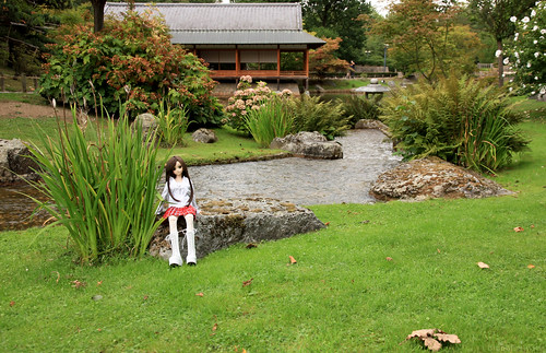 Yoko with Japanese ceremonial house in the background