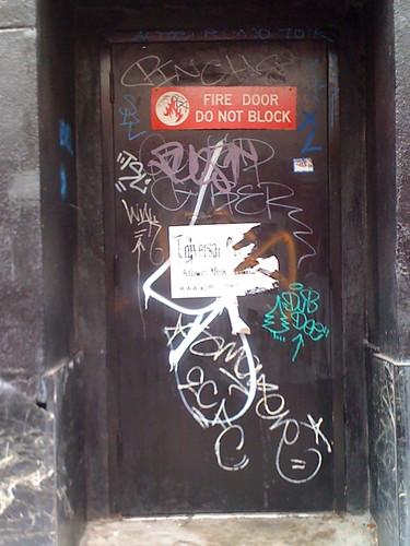 Back Door of $5 store on C Street