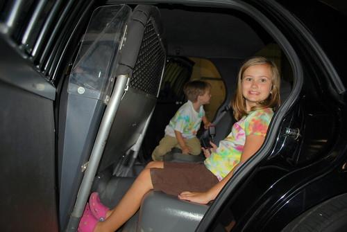 kids in a cop car