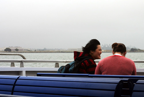 a girl laughing on a ferry