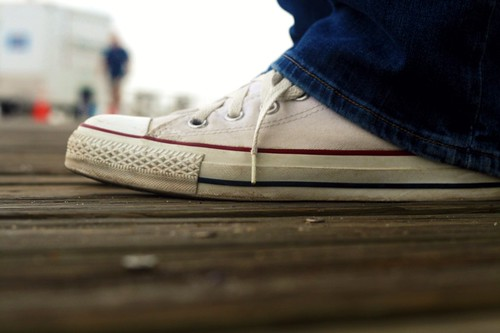 white chucks on the boardwalk