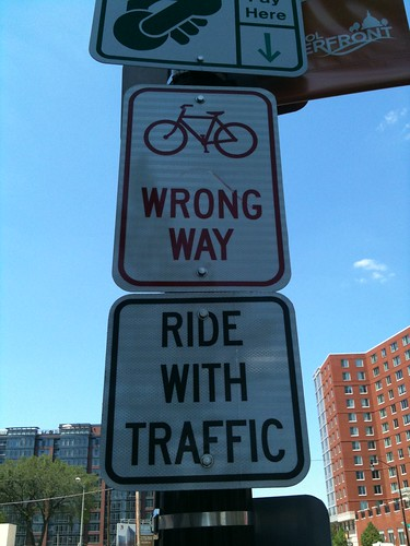 "A sign that say ""Bike with traffic"""