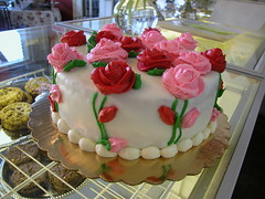 Giant Petit Four Cake with Red and Pink Icing Roses