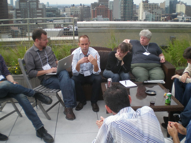 A group of participants discussing caption metadata