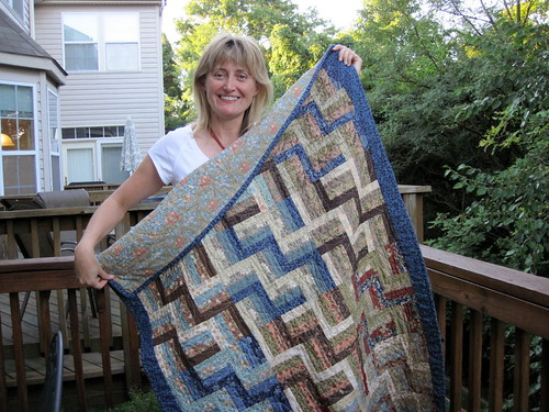 Jen showing off a quilt I made for her