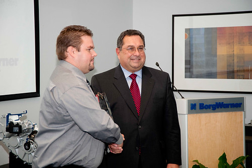 ZAP Alias Team Member Mike Mills Accepting Innovation Award from BorgWarner CEO Tim Manganello