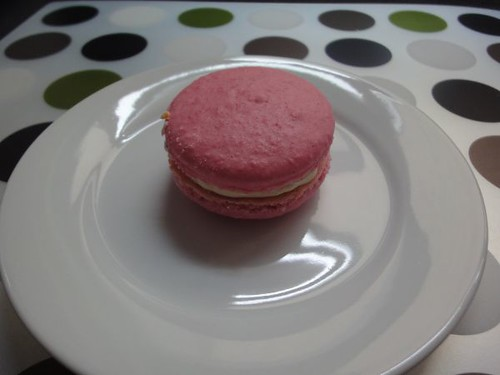 Rose water butter cream with strawberry jam macaron