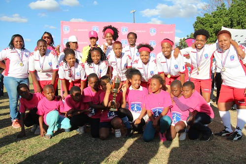 All star Ladies team with some of the adolescent girls