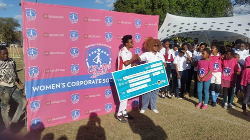 Sasha Goening receiving the top goal scorer award from FNB who were part of the sponsors of the tournament