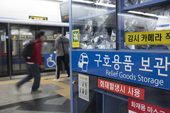 Residents of Seoul, the capital city of South Korea, walking past a relief goods storage in a subway station. Despite recent tensions with North Korea, life and business in Seoul is normal, October 13, 2017.