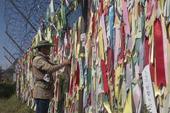 A South Korean man arranges colorful ribbons in Imjingak Park near the Demilitarized Zone (DMZ) on October 14, 2017 in the city of Paju, South Korea. North Korea renewed its threats to launch ballistic missiles around the U.S. Territory of Guam.